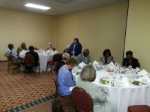 Beverly Reese, Philadelphia, PA ask blessing of banquet meal at 57th SEC