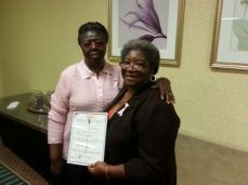 Ernestine Porter, Moncks Corner, SC proudly display certificate of appreciation as devotional book lesson writers.